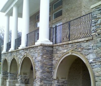residential forged iron railing with belly pickets