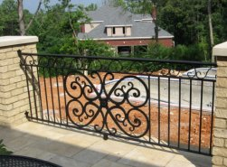 wrought iron deck railing with plasma cut scroll design