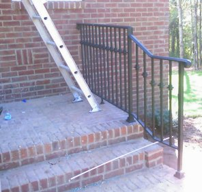 wrought iron railing with wide moulded cap and cast iron collars
